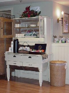 An antique cupboard adds style to the reading room/kitchen area.